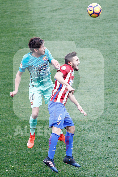 Atletico de Madrid's Koke Resurrecccion (r) and FC Barcelona's Sergi Roberto during La Liga match. February 26,2017. (ALTERPHOTOS/Acero)
