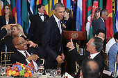 United States President Barack Obama (C) greets other world leaders and ambassadors during a luncheon hosted by United Nations Secretary-General Ban Ki-moon at the 70th annual UN General Assembly at the UN headquarters September 28, 2015 in New York City. Obama held a bilateral meeting with Indian Prime Minister Narendra Modi and will have a face-to-face meeting with Russian President Vladimir Putin later in the day. <br /> Credit: Chip Somodevilla / Pool via CNP