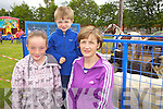 Sinead, Ciaran and Mary Hunt from Athea enjoying the Abbeyfeale Parish Fete held for World Youth Day and St Mary's Boys NS held last Sunday afternoon in Fr Casey's GAA.