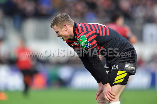 Chris Ashton takes a breather during a break in play. Heineken Cup match, between Saracens and Connacht Rugby on January 18, 2014 at Allianz Park in London, England. Photo by: Patrick Khachfe / JMP