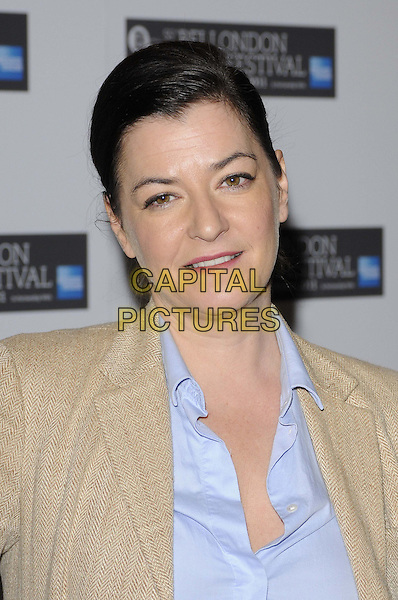 "Lynne Ramsay, director.The ""We Need To Talk About Kevin"" press conference & photocall, London Film Festival, Day 6, Vue West End cinema, Leicester Square, London, England..October 17th, 2011.LFF headshot portrait beige jacket blue shirt  .CAP/CAN.©Can Nguyen/Capital Pictures."