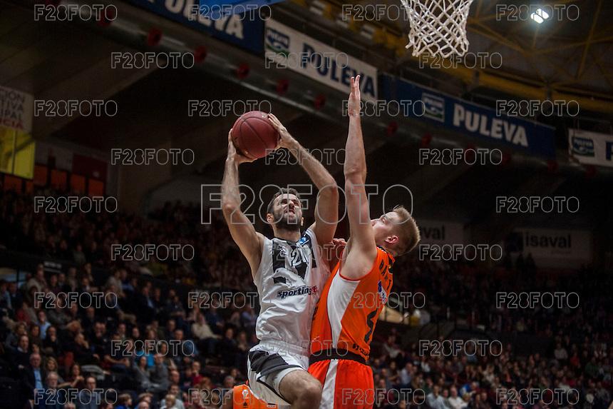 VALENCIA, SPAIN - JANUARY 6: Nikola Markovic and Justin Hamilton during EUROCUP match between Valencia Basket and PAOK Thessaloniki at Fonteta Stadium on January 6, 2015 in Valencia, Spain