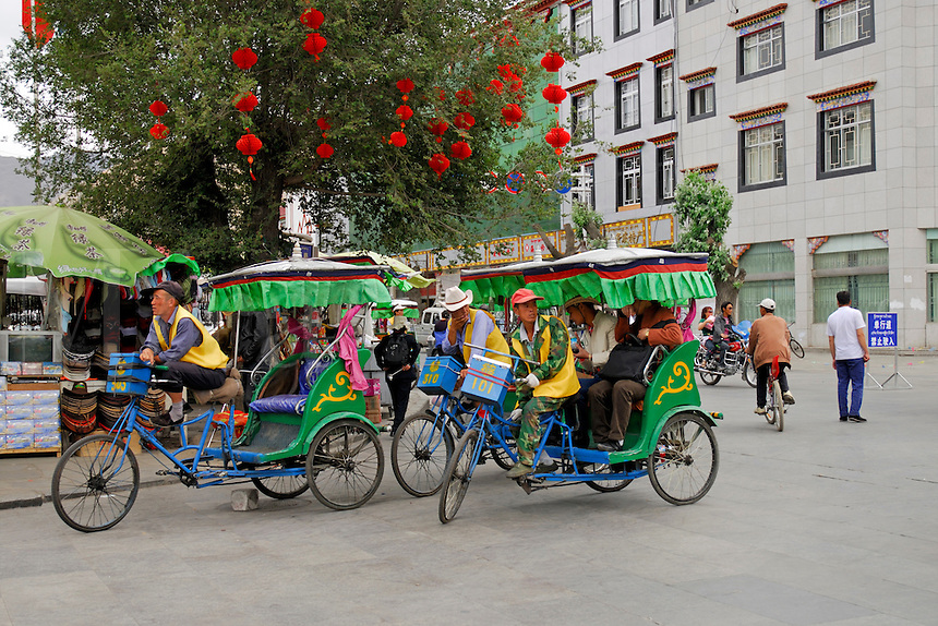 Rickshaws waiting for passengers at the corner of Barkhor Square, Lhasa, Tibet.