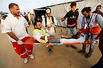 A Palestinian protester who was wounded during clashes with Israeli froces at the Israel-Gaza border, is carried on stretcher, in Khan Younis in the southern Gaza Strip on October 19, 2018. Photo by Ashraf Amra
