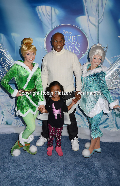"Mike Tyson and daughter Milan  and Tinker Bell and Periwinkle attends the Premiere of ""Secrets of the Wings"" on October 20, 2012 at The AMC Loews Lincoln Square in New York City. The Disney 3-D movie stars the voices of Anjelica Huston, Mae Whitman, Timothy Dalton, Raven -Symone and Matt Lanter. The movie will be released on Tuesday on DVD and Blu Ray."