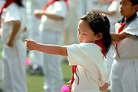 Children perform their morning exercise rituals at the first primary school attached to the XuanWu District normal school. XuanWu is located the south western part of the central city area, just outside the Imperial Inner City. In 2010, Xuanwu District was merged into Xicheng..