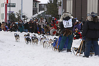 Saturday March 6 , 2010   Tamara Rose on Cordova street waves to spectators during the ceremonial start of the 2010 Iditarod in Anchorage , Alaska