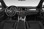 Stock photo of straight dashboard view of 2017 BMW X3 xDrive28d 5 Door SUV Dashboard