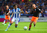 Huddersfield Town's Isaiah Brown vies for possession with Sheffield Wednesday's Barry Bannan<br /> <br /> Photographer Andrew Vaughan/CameraSport<br /> <br /> The EFL Sky Bet Championship Play-Off Semi Final First Leg - Huddersfield Town v Sheffield Wednesday - Saturday 13th May 2017 - The John Smith's Stadium - Huddersfield<br /> <br /> World Copyright &copy; 2017 CameraSport. All rights reserved. 43 Linden Ave. Countesthorpe. Leicester. England. LE8 5PG - Tel: +44 (0) 116 277 4147 - admin@camerasport.com - www.camerasport.com