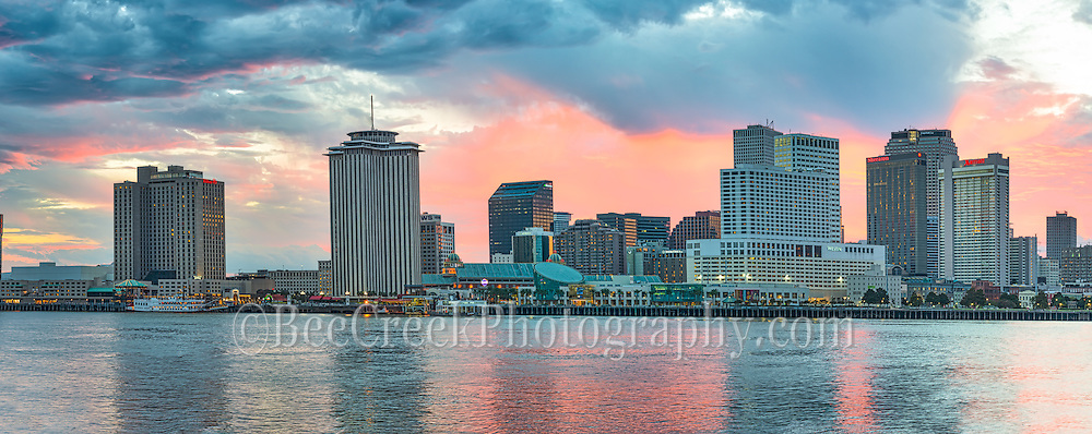 There were some dark clouds moving in over New Orleans skyline, but as sunset came the sky lit up with these oranges, pinks and yellow color that reflected in the Mississippi River along the water front.