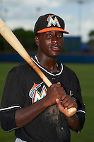 GCL Marlins outfielder Isaiah White (12) poses for a photo before the second game of a doubleheader against the GCL Mets on July 24, 2015 at the St. Lucie Sports Complex in St. Lucie, Florida.  GCL Marlins defeated the GCL Mets 5-4.  (Mike Janes/Four Seam Images)