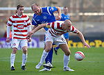 Hamilton Accies v St Johnstone..23.10.10  .Simon Mensing fends off Sam Parkin.Picture by Graeme Hart..Copyright Perthshire Picture Agency.Tel: 01738 623350  Mobile: 07990 594431