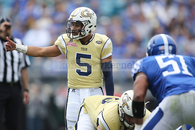 Quarterback Justin Thomas #5 of the Georgia Tech Yellow Jackets directs the offense during the second half of the TaxSlayer Bowl against the Kentucky Wildcats at EverBank Field on Saturday, December 31, 2016 in Jacksonville, Florida. Photo by Michael Reaves | Staff.