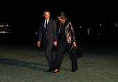 United States President Barack Obama and first lady Michelle Obama arrive at the White House in Washington, DC on April 11, 2014 following a trip to New York.  <br /> Credit: Dennis Brack / Pool via CNP