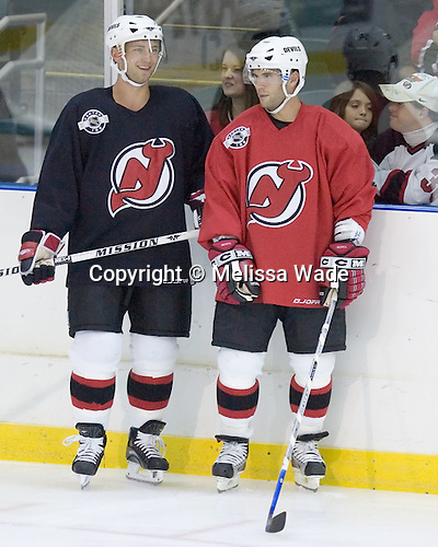 Brian Rafalski and Brian Gionta wait for their turn in a drill. The New Jersey Devils took part in a special evening practice on Friday, September 22, 2006 at the Richard E. Codey Rink at their South Mountain training facility to benefit Essex County Parks.  The practice took place before a preseason game between their AHL affiliate Lowell Devils and the Philadelphia Phantoms.