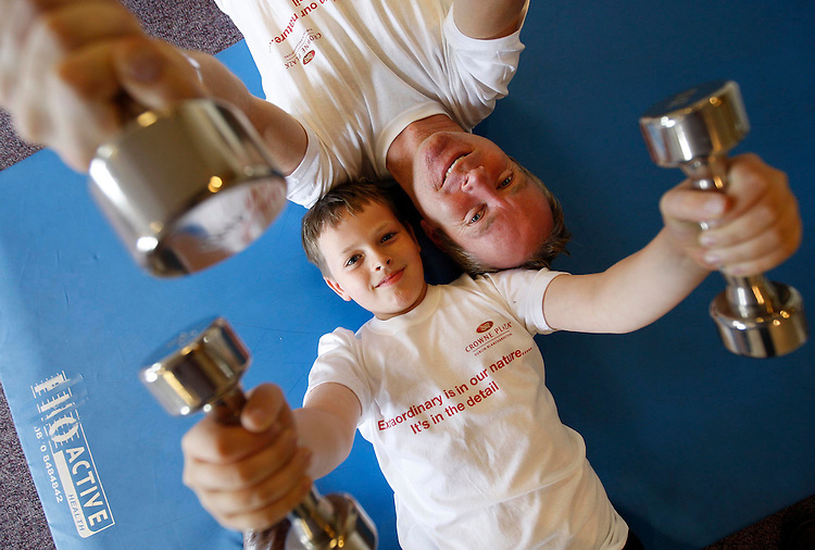 Extraordinary is in our nature......Ireland's youngest Mountineer, Sean McSharry, age 10 from Stillorgan, Dublin pictured here pumping iron with his Godfather, Ian McKeever in the Crowne Plaza Hotel, Santry in preperation for their ascent of Mount Ebrus, Russia this weekend. Pic. Robbie Reynolds.