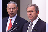 Washington, DC - September 24,  2001 -- United States President George W. Bush announces an Executive Order directing financial institutions to put a freeze on the assets of certain entities that may be fronts for terrorist activities as U.S. Secretary of State Colin Powell looks on from left..Credit: Ron Sachs / CNP