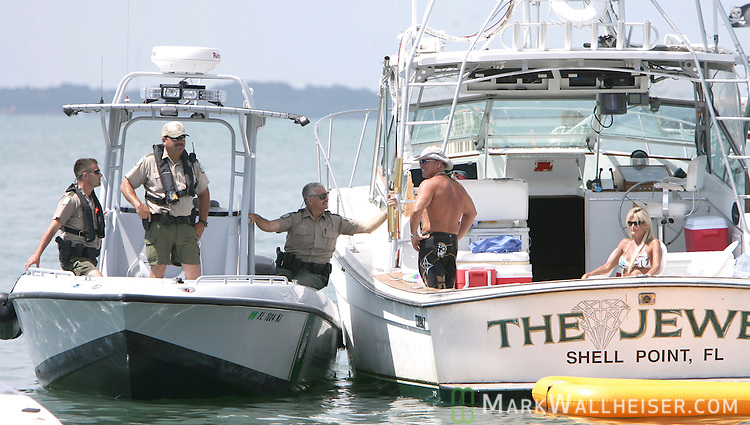 "Fourty law enforcement officers from four agencies came to the White Trash Bash Memorial Day weekend at Dog Island off the coast of Carrabelle Sunday May 27, 2007. The officers made 10 arrest for boating under the influence out of over 350 boats that attended.  ""We just want them to be safe"" said Cpt Craig Duval, an area supervisor with the Florida Fish and Wildlife Commission.  (Photo by Mark Wallheiser/TallahasseeStock.com)  (Mark Wallheiser/TallahasseeStock.com)"