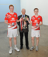 21st September 2013; Willie Roche, president elect of GAA handball, presents the cup to Michael Hedigan and Daniel Relihan, Cork, after their win in the Minor Doubles Final. GAA Handball, All-Ireland Finals, Broadford Handball Club, Co Limerick. Picture credit: Tommy Grealy/actionshots.ie.