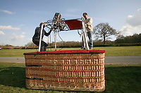 Fixing the propane burners to the wicker basket, British School of ballooning, Ebernoe, West Sussex.