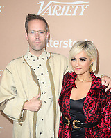 LOS ANGELES, CA - DECEMBER 1: Justin Tranter, Bebe Rexha, at Variety's 2nd Annual Hitmakers Brunch at Sunset Tower in Los Angeles, California on December 1, 2018.     <br /> CAP/MPI/FS<br /> &copy;FS/MPI/Capital Pictures