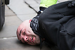 "© Joel Goodman - 07973 332324 . 28/03/2015 . Manchester , UK . A man is arrested . Approximately 100 neo-Nazis gather in Manchester for "" White Pride Worldwide day "" . Photo credit : Joel Goodman"