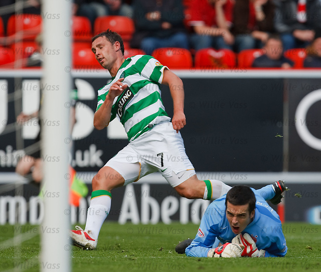 Scott McDonald scores his second goal past keeper Jamie Langfield to seal a 3-1 win for Celtic