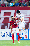 Guangzhou Forward Alan Douglas De Carvalho (L) fights for the ball with Kashima Defender Ito Yukitoshi (R) during the AFC Champions League 2017 Round of 16 match between Guangzhou Evergrande FC (CHN) vs Kashima Antlers (JPN) at the Tianhe Stadium on 23 May 2017 in Guangzhou, China. (Photo by Power Sport Images/Getty Images)