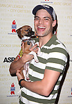 Jeremy Jordan (Newsies)  .backstage at Broadway Barks 14 at the Booth Theatre on July 14, 2012 in New York City. Marking its 14th anniversary, Broadway Barks!, founded by Bernadette Peters and Mary Tyler Moore helps many of New York City's shelter animals find permanent homes and also inform New Yorkers about the plight of the thousands of homeless dogs and cats in the metropolitan area.