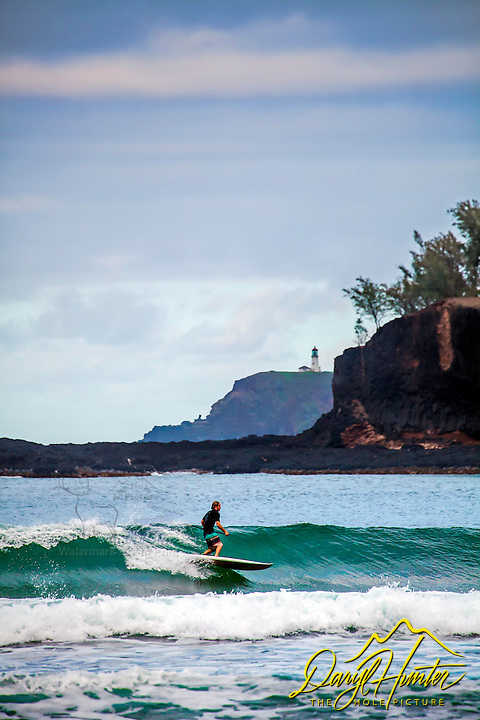 Surfer and Kilauea Lighthouse from  Kilihiwai Beach Kauai