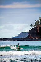 Surfer and Kilauea Lighthouse from  Kilihiwai Beach Kauai