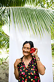 INDONESIA, Mentawai Islands, Kandui Resort,  portrait of a smiling Mentawai elder with tattos named Tatiana