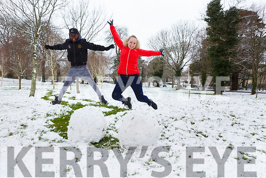 Taking the snow to a great new height as Sinead O'Sullivan and Mike Kamwana are having fun in the town park on Friday morning last.