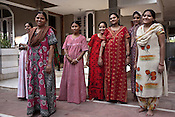 Surrogate mothers pose for a photograph outside Rabina's house in Anand, Gujarat, India. Rabina now mentors surrogate mothers and houses women throughout their pregnancy.