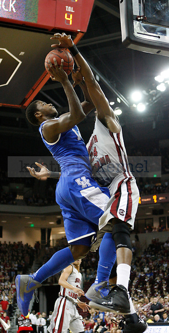 UK forward Michael Kidd-Gilchrist attempts to shoot over South Carolina's Damontre Harris during the first half of the University of Kentucky Men's basketball game against University of South Carolina on 2/4/12 in Columbia, SC. Photo by Quianna Lige | Staff