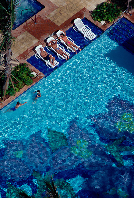 Sunbathers at swimming pool, San Juan Marriott Hotel, Condado, San Juan, Puerto Rico, West Indies