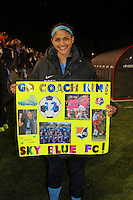 Piscataway, NJ, May 7, 2016. Sky Blue midfielder Kim DeCesare (12) shows off a sign made for her by a local youth team.  The Western New York Flash defeated Sky Blue FC, 2-1, in a National Women's Soccer League (NWSL) match at Yurcak Field.