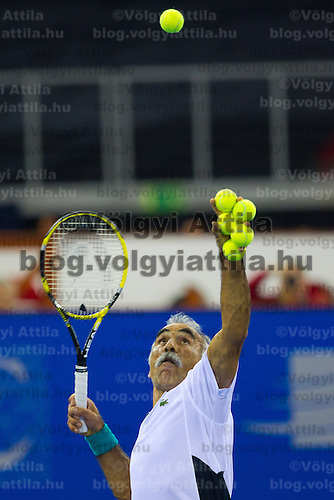 Mansour Bahrami from Iran serves during an exhibition duo match together with Fernando Verdasco (not pictured) from Spain against Gael Monfils (not pictured) and Fabrice Santoro (not pictured) from France during the Tennis Classics tournament in Budapest, Hungary on October 29, 2011. ATTILA VOLGYI