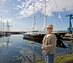 I saw the masts from afar and knew it was not a usual boat in the boat haven. I went to the docks and found this lady walking along side. It turns out she is the owner, along with her husband. They had overnighted in Port Townsend before crusing on the Seattle and then onto the Caribbean. The photo, which I sent in as wild art was used the next day.