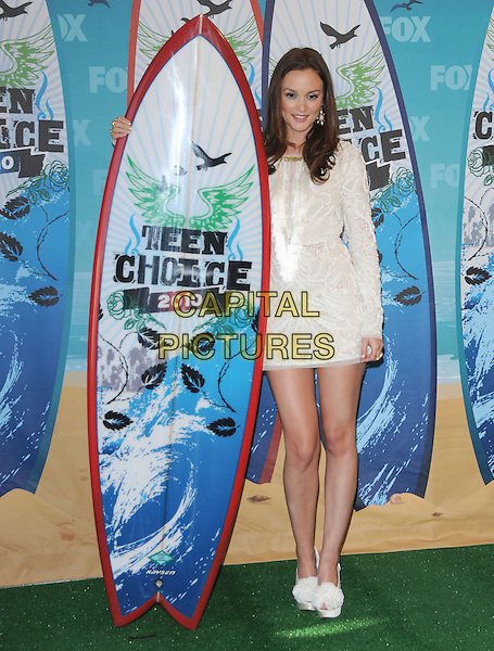 LEIGHTON MEESTER .Fox Teen Choice 2010 Awards Press Room at the Universal Ampitheatre in Universal City, California, USA,.August 8th 2010.  .full length cream white dress patterned long sleeve mini platform christian louboutin shoes flower corsage jewel encrusted sparkly diamante mesh silk satin peep toe surf board                                                            .CAP/RKE/DVS.©DVS/RockinExposures/Capital Pictures.