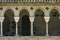 A side of the magnificent cloisters at the Benedictine Abbey of St. Pierre in Moissac showing some detail of the capitals. This treasure of Romanesque architecture was founded in the 7th Century and took nearly 200 years to complete because of incursions by Moorish and Viking invaders.