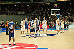 Real Madrid´s players and Anadolu Efes´s players during silence minute before the 2014-15 Euroleague Basketball match between Real Madrid and Anadolu Efes at Palacio de los Deportes stadium in Madrid, Spain. December 18, 2014. (ALTERPHOTOS/Luis Fernandez)