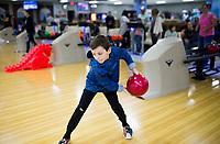 NWA Democrat-Gazette/CHARLIE KAIJO Drew Houghland, 6, of Farmington bowls, Sunday, February 11, 2018 at the Rogers Bowling Center in Rogers. Low temperatures left many of the roads icey. <br />