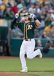 Josh Donaldson celebrates his 3 run home run as he heads for home plate.<br />