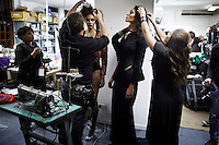 CAPE TOWN, SOUTH AFRICA - JULY 26: Models being dressed before an installation show at the new Klûk CGDT flagship store during Mercedes-Benz Fashion Week on July 26, 2014, in Cape Town, South Africa. Klûk CGDT, created by the designers Malcolm KLûK and Christiaan Gabriel Du Toit. The elite of Cape Town came out for the launch of the store and the late night party. (Photo by Per-Anders Pettersson)