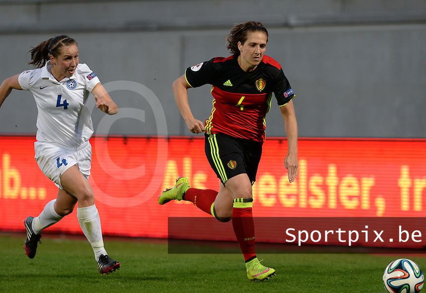 20160412 - LEUVEN ,  BELGIUM : Belgian Maud Coutereels (4)  pictured in a duel with Estonian Pille Raadik (left) during the female soccer game between the Belgian Red Flames and Estonia , the fifth game in the qualification for the European Championship in The Netherlands 2017  , Tuesday 12 th April 2016 at Stadion Den Dreef  in Leuven , Belgium. PHOTO SPORTPIX.BE / DAVID CATRY