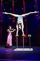London, UK. 10.04.2014. Australian circus ensemble, Company 2, bring SHE WOULD WALK THE SKY to the Roundhouse, as part of CircusFest 2014. Picture shows: Alex Mizzen (the Distant One) and Sue Simpson (The Red Woman - violin). Photograph © Jane Hobson.