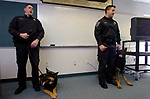 FILE....Manchester Officer Richard Boyle and  his dog Marko and Manchester Police Officer Michael Ilewicz (ILEWICZ) and   Vegas, after a K9 vest presentation Friday at Manchester Police Headquarters, the 2 K9 teams received the vests by the Christina Poryanda, Executive Director of Connecticut Vest-A-Dog. A Jim Michaud pic 2/23/06