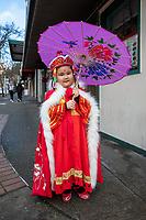 Cute asian girl wearing traditional clothing, Chinese New Year Celebration, Chinatown, Seattle, WA, USA.