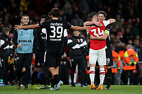 Eintracht Frankfurt captain, David Abraham celebrates their victory at the final whistle by embracing Arsenal's Granit Xhaka during Arsenal vs Eintracht Frankfurt, UEFA Europa League Football at the Emirates Stadium on 28th November 2019